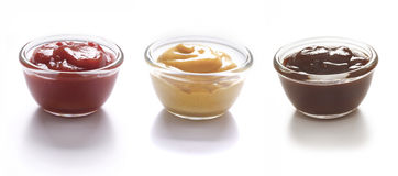 Tomatketchup, senap och grillfestsås Royaltyfria Foton