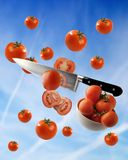 Tomato. A photo montage of tomatoes and knife Stock Photo