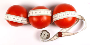 Tomato. Es with measuring tape isolated on white stock image
