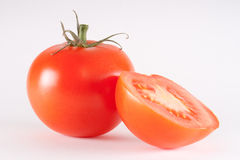Tomato. Fresh red tomato with half isolated on white background Royalty Free Stock Photography