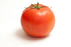 Tomato. The tomato in the white background Stock Images