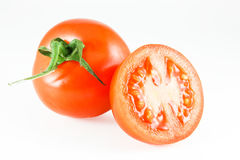 Tomato. A whole and one half tomato Royalty Free Stock Image