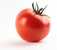 Tomato. One tomato with leaves and stem isolated on the white Stock Images