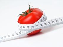 Tomato. With tape measure Stock Photos