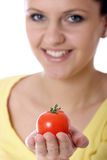 Tomato. Stock photo of a young woman holding fresh tomato royalty free stock images