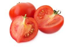 Tomato. Fresh tomato isolated on white Stock Photos