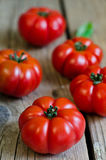 Tomato. Fresh tomatoes on a wooden table Stock Photography