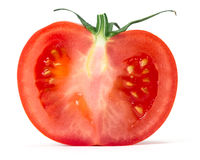Tomato. Slice of red tomato over white background Royalty Free Stock Photo