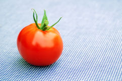 Tomato. Fresh red organic tomato on the table Royalty Free Stock Image