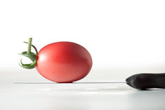 Tomato. On the knife with white background Royalty Free Stock Image