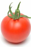 Tomato. A red ripe tomato on a white surface Royalty Free Stock Photography