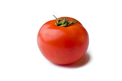 Tomato. Single ripe tomato isolated on white background royalty free stock images