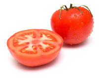 Tomato. The cut tomato on white. Shallow DOF Royalty Free Stock Images