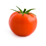 Tomato. A tomato viewed from 3/4 front with its leaves. Laid on a pure white background with clipping path (excluding the drop shadow royalty free stock image