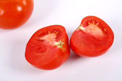 Tomato. Cut tomatoes in isolated white background Stock Photos