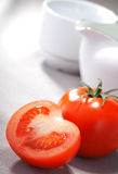 Tomato. Slice on kitchen table Royalty Free Stock Image