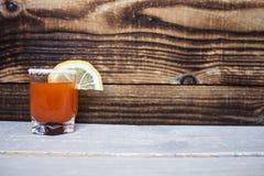 Tomato alcohol shot drink with lemon and salt Stock Photo