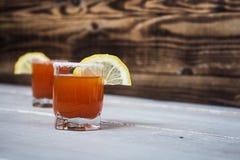 Tomato alcohol shot drink with lemon and salt Stock Image