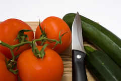 Tomato And Courgette With Knife Royalty Free Stock Photos