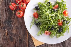Tomato and arugula salad Stock Photo