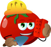 Tomato as bricklayer with brick and trowel Stock Photography
