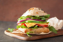 Tomato avocado cheese sandwich with cucumber onion Royalty Free Stock Image