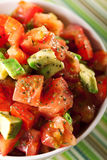 Tomato and avocado salad Stock Images