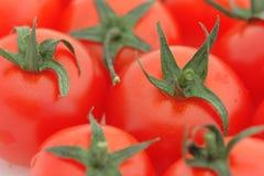 Tomato background. Close-up of a tomato heap. Shallow DOF Stock Photo