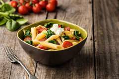 Tomato and Bacon Penne Pasta Stock Images