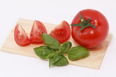 Tomato with basil Royalty Free Stock Images