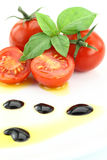Tomato and basil. Garnished with olive oil and balsamic vinegar Royalty Free Stock Images