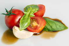 Tomato, basil and balsamic wine Royalty Free Stock Photos
