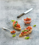 Tomato and basil bruschetta sandwich over grunge Royalty Free Stock Images