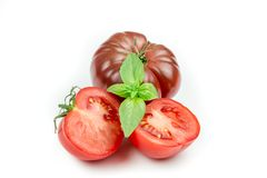 Tomato and basil leaf isolated Stock Photography