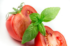 Tomato and basil leaf isolated Stock Photo