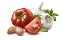 Tomato, basil leaves, garlic bulbs, cloves 2 isolated Stock Photos