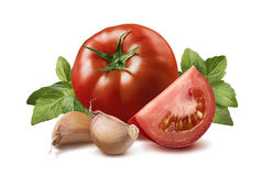 Tomato, basil leaves, garlic cloves 3 isolated on white Stock Photo