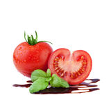 Tomato with Basil over Balsamic Vinegar Royalty Free Stock Image