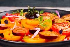 Tomato, basil, parsley, dill and onion salad. Tomato, basil, parsley, dill and onion salad, vertical Royalty Free Stock Photos