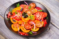 Tomato, basil, parsley, dill and onion salad. Tomato, basil, parsley, dill and onion salad, vertical Royalty Free Stock Images