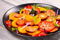 Tomato, basil, parsley, dill and onion salad. Tomato, basil, parsley, dill and onion salad, vertical Stock Images