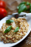 Tomato and basil risotto Stock Photography