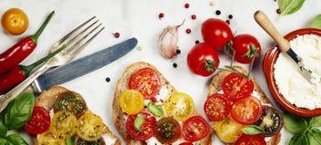 Tomato and basil sandwiches Stock Photos