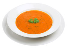 Tomato & Basil Soup. Tomato & basil soup garnished with a sprig of parsley Stock Photo