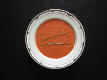 Tomato Basil Soup. Served in porcelain bowl Royalty Free Stock Photo