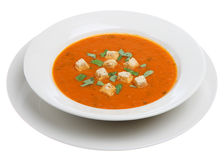 Tomato and Basil Soup. Garnished with torn basil leaves and croutons Royalty Free Stock Image