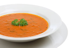 Tomato and Basil Soup. Bowl of tomato and basil soup garnished with parsley Royalty Free Stock Image
