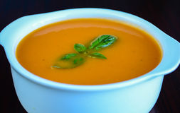 Tomato and Basil Soup. Tomato soup in a bowl with healthy and fresh ingredients and herbs Stock Photography
