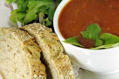 Tomato Basil Soup with Bread and Salad Royalty Free Stock Photo