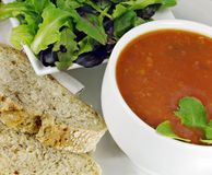 Tomato Basil Soup with Bread and Salad Royalty Free Stock Photography